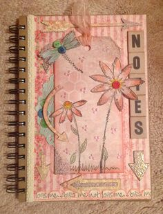 Altered notebook using Jofy 13 and Tim Holtz artful arrows.