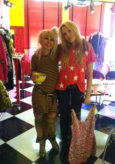 What an animated pair! Lulu got into the spirit of the Betsey Johnson brand by donning a star-print red tee while picking out her looks for her mom's show at New York Fashion Week fall 2012. - Pin your favorite Betsey Johnson images for a chance to win a $500 Betsey Johnson shopping spree and be featured on TV as Style Network's Pinner of the Week! http://www.stylenetwork.com/betseypinitsweeps