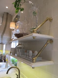 This shelving is great. It is mounted onto a wall of ceramic tile in a kitchen. The metal pipe brace is probably custom. So cool