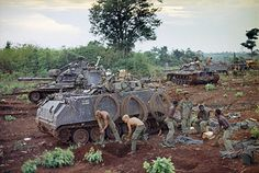 "M113 acav 11 ACR ""Blackhorse"" - U.S. soldiers of an armored unit dig in as they advance into Cambodia, about 10 miles north of Katum base in South Vietnam, in May 1970. Photo by Henri Huet ~ Vietnam War"