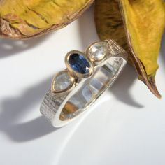Blue and white sapphire silver and gold ring Gold And Silver Rings, Silver Jewelry, Bespoke Jewellery, Bronze Sculpture, White Sapphire, Metal Working, Gemstone Rings, Blue And White, Metalworking