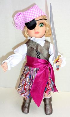 Her pirate outfit consists of a long sleeve white blouse, a multi-color zig-zag stripe skirt, a laced-up brown pleather vest, a wide maroon satin ribbon belt, a brown pleather buckled strap, a purple gingham head scarf, a black eyepatch, white socks, and brown pleather boots.Patsy holds a pirate sword in her left hand. | eBay!