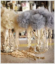 "tulle decor. Tulle ball wands...These could be made ""tall"" and the sticks wrapped with ribbon and have ribbon streamers hanging down from the top like a balloon."