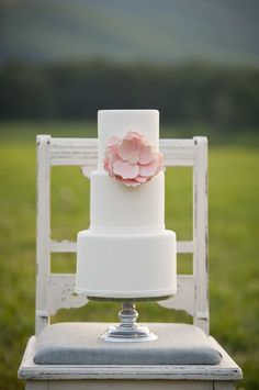 Simple 3 tiered round wedding cake with fondant ice and one simple pink statement bloom. www.facebook.com/LFFdesigns