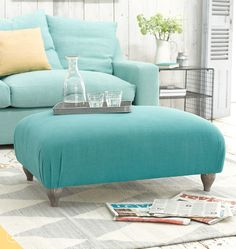 Mint colored sofa and footstool