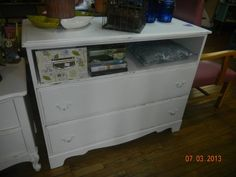 Old wood dresser..I was missing a couple knobs and instead of purchasing new ones, decided to use the space as storage..Love this piece!