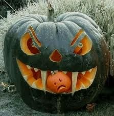 green scary Pumpkin with fangs eating sad little pumpkin