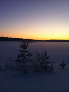 The sun is rising and it is a cold winter morning at ski resort Luosto in Lapland Finland.