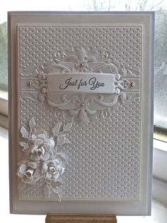 Something simple today using my new spellbinders embossing folder called petite framed label, SB fleu de lis motifs, SB labels four, SB fancy tags one, the roses I made using cheery lynn rose dies medium and large, they are so easy to do , I usually make them while watching TV, and they have been dipped in cyrstal glitter, the leaves are also by cheery lynn. As always my card is from Anna marie designs.