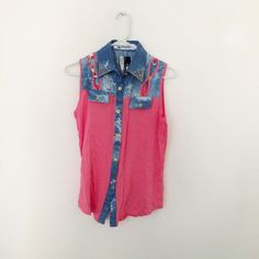 Pink and denim sleeveless top Size small. NWT from a store in Hong Kong. Has small cutouts on the yoke. NO SWAPS Tops Tank Tops