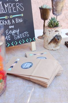 "Navajo Theme. Arrows. ""Thank you"" bags. Candy buffet. Succulents.  Photo Credit: Cori Kleckner Photography"