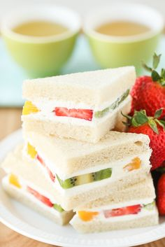 Fruit Sando are a Japanese specialty, known for having pieces of soft fruit among a filling of lightly sweetened whipped cream. These are reminiscent of those fluffy, fruited, Asian style bakery cakes Tea Party Sandwiches, Finger Sandwiches, Sandwich Bar, Kolaci I Torte, Fruit Tea, Bakery Cakes, Tea Recipes, Tea Sandwich Recipes, Cucumber Recipes