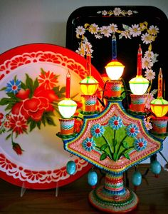 mexican details......That candlebra in the foreground...The bottom of it looks like a fan. Idea to make a decorative wool felt fan with hand embroidery in bright colors.