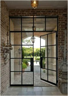 Steel Frame Industrial Doors I am absolutely in love with steel frame industrial doors. I have been day-dreaming lately of our upcoming home renovation project. We are hopefully buying a Renovation Iron Doors, Industrial Door, Steel Frame, House Exterior, French Doors Exterior, Loft Door, Doors Interior, Exterior Door Designs, Door Glass Design
