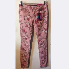 MUST GO!  NWT Almost Famous floral skinny legged jeans in light maroon. New with tags! Almost Famous Jeans