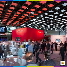 """MC² designed a 15,000 sf. projection screen for Swiss family business Ferag at Drupa in Dusseldorf, Germany. This soccer pitch-sized LED canopy communicated """"Swissness"""" in its purest form with a projected image of a fluttering Swiss flag. Drupa is the largest printing equipment exhibition in the world!  #screen #exhibit #exhibition #printing #tradeshow #drupe"""