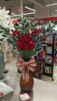 Country home Christmas feel. Red hydrangeas and holly .