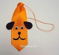 Gravatas com carinha de cachorrinho em fita cetim. Cores variadas.    Disponíveis nos tamanhos:  - P: 3,8 x 9,5cm  - M: 3,8 x 12cm  - G: 3,8 x 15cm  Você pode escolher entre:  - embalagem padrão contendo 10 unidades, sendo 3 gravatas tam. P, 4 gravatas tam. M e 3 gravatas tam. G em cores variadas...