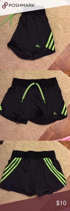 Doesn't fit anymore Bright green color on the sides is my favorite but they just don't fit anymore...great running shorts or weightlifting shorts, only worn twice, good condition! Adidas Shorts