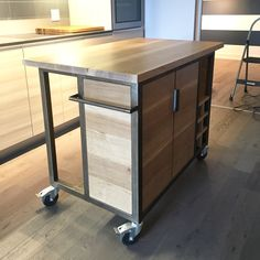 Custom kitchen island cart made by us for a condo size kitchen. Solid white oak and metal.