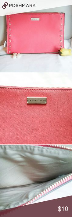"""NWT New York & Company Coral Pouch From NY & Co. is this smart, crystal and silver tone stud trimmed, salmon colored, zippered pouch. It measures 10"""" x 7"""" and is made from polyvinyl.  It's great to enclose your tablet or other items you would like to keep separate in your purse. Or, it is lovely carried as a clutch.  🛍 Bundle and Save More! New York & Company Bags Clutches & Wristlets"""