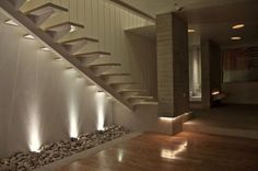Stairs. open modern, love the uplighting from rocks bed underneath. great feature