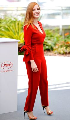 JESSICA CHASTAIN : When you're on the official Cannes Film Festival jury, you need to stand out. Chastain clearly got the memo at the jury photo call, dressed to impress in a low-cut red jumpsuit, gold sandals and a matching red mani/pedi combo.