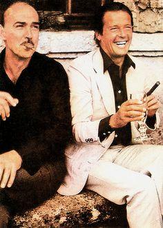 Sean Connery, Roger Moore  Romanian postcard by Casa Filmului Acin.