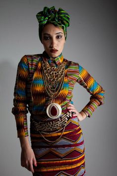 Layerings: African textiles over yuppie cut shirt; head wrap with urban look; beadwork and chains; 3 distinct textiles.
