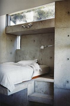 Concrete bedroom nook.