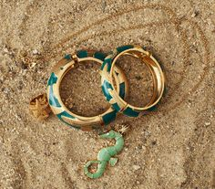 Seahorse necklace and green and gold bracelets
