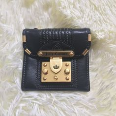 NWOT Juicy Couture Black Leather Frame Lock Wallet inside it has six credit card slots, a zippered compartment for change and a bill holder. Juicy Couture Bags Wallets