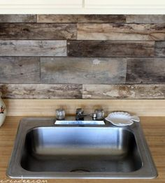 If you want to change the look of your kitchen on a budget you can make a new backsplash for it. In order to minimize your expenses you can reuse different materials like wine corks or reclaimed wood from old shipping pallets.