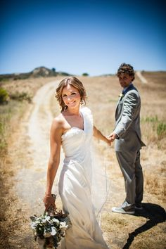 Chillin on a Dirt Road, She is looking at the camera, he is looking at her.