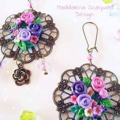 Earrings in fimo and watermark made by https://www.facebook.com/Maddalena-Scarpato-Design-579880538739298 *** Le Maddine & Maddy https://www.facebook.com/groups/531953423561246/ ***  #madeinfacebook #lemaddine #handmade #handcrafted #instagram #instapic #instagood #picoftheday #instacool #handmade #cool #cute #spring #jewelry #jewellery #jewels #jewel #bijoux #handmadejewelry #fimo #polymerclay #earrings #flowers #watermark #metal #colorful #maddalenascarpatodesign