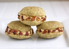 Fat Elvis Whoopie Pies - Banana cakes sandwiching a thick layer of creamy peanut butter frosting with the edges rolled in salty crumbled bacon. Drooling yet?