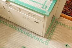 Kitchen in Mint Condition--The counter top and floor tiles were installed in the 1930s. The deep bin drawer now houses a dishwasher.