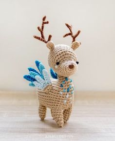 Fantasy reindeer with antlers and blue wings.
