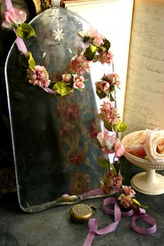 Beautiful vintage mirror and floral garland, via Matthew Mead