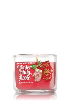 """Winter Candy Apple - Mini Candle - Bath & Body Works - Made using the highest concentration of fragrance oils and an exclusive blend of vegetable wax and lead-free wicks, our Mini Candles are contained in elegant glass and topped with a flame-extinguishing lid. Mini Candle burns approximately 10-15 hours and measures 2"""" wide x 1 3/4"""" tall."""