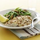 Classic and simple fish baked in margarine, lemon, dill, and garlic, topped with delicious toasted almonds. Calories 258, Total Carbs   .6 g, Sugars .2 g