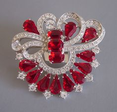 EISENBERG ICE Classic 1994 red and clear rhinestone brooch.