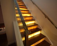 I wonder what material would work best that could take the beating of a typical staircase and still allow the light through all while looking good...the other question is how do you change the bulbs if/when they burn out.