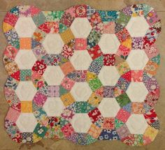 """Shop sample I made in May 2009 called """"Ferris Wheel"""" by paperpieces.com using 1930's reproduction fabric.  The EPP pieces are 1"""" and I hand quilted."""