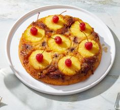 The combination of rich, buttery cake and caramelized pineapples in this classic dessert will transport guests to the good ol' days. It's traditionally made in a cast-iron skillet, but a or cake pan will also get the job done in a pinch. Cast Iron Skillet Dessert Recipe, Cast Iron Skillet Cooking, Iron Skillet Recipes, Cast Iron Recipes, Skillet Pineapple Upside Down Cake Recipe, Pineapple Upside Cake, Pinapple Cake, Cake Recipes, Sweets