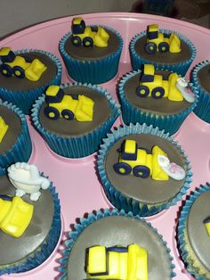 Baby shower cupcakes with a yellow digger theme for baby boy. before final edible rumble was added. tplh