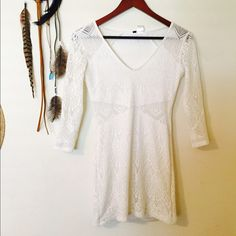 White Quarter-Sleeve Dress Worn once. No stains or snags. Nice white dress with lace detail on the sides and back(shoulders). Has a built in slip on the inside. **Tagged Urban for views.** Urban Outfitters Dresses Mini