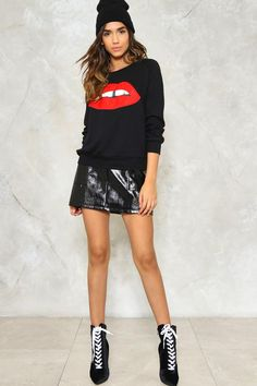 Mwah. The Lip It Good Sweatshirt features a ribbed crew neckline, hem, and cuffs, and lip graphic at front. Wear it tucked into a vegan leather skirt.