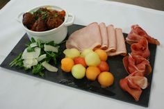 Starter: Parma Ham, Kassela smoked Pork Loin, and Spanish Meatballs with Melon Rocket and Shaved Parmesan Cheese