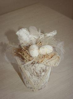 Easter decoration. ( painted fibre pot, fabric bird and decorative elements.)